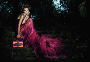 Evening scenic - fairy girl in long dress sitting on staircase in the dark forest - series of photos